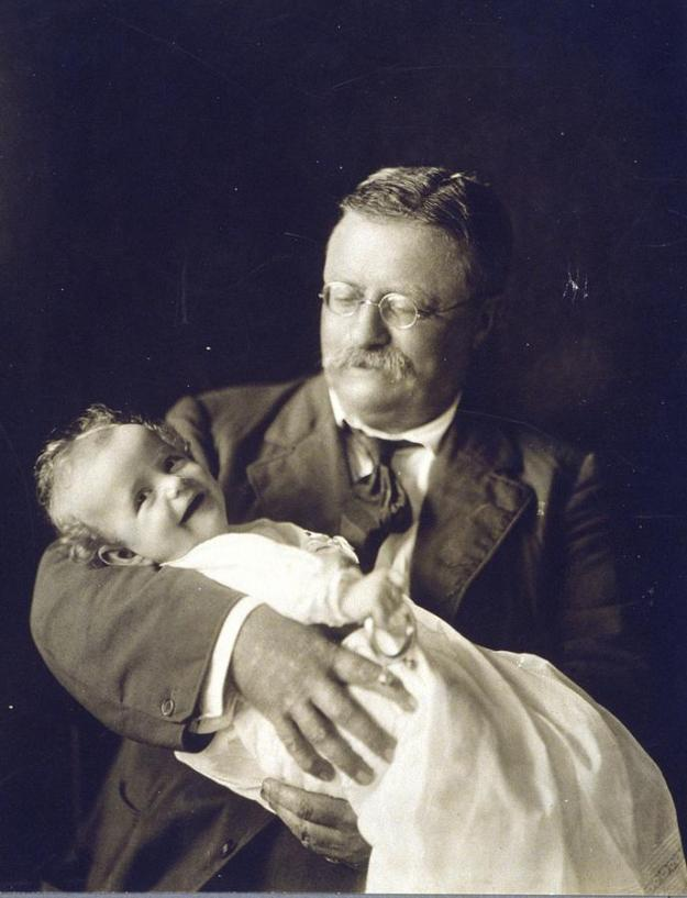 theodore-roosevelt-smiling-as-he-holds-everett.jpg